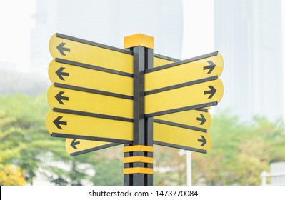 Different way of arrow yellow sign at the road in the big city
