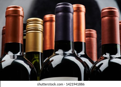 Different wine bottles close up view of stack