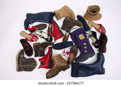 A lot of different women's and men's shoes on a white background