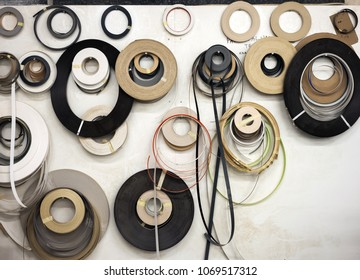 Different wooden and plastic edge banding tapes at carpenter's workshop