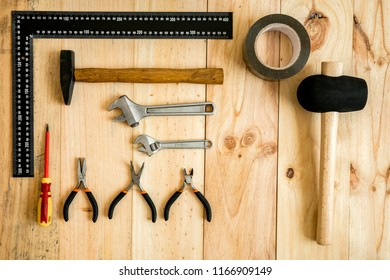 Different working and repair tools on a wooden background