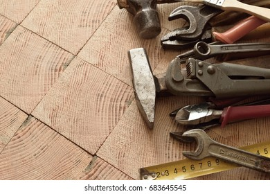 different working tools on a wooden surface