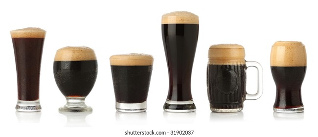 Differente glasses of stout beer, isolated on white