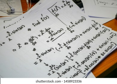 Differentiation solving problem, equations outlines on white paper, Mathematics notation ,calculus for  engineering and scientific studying.