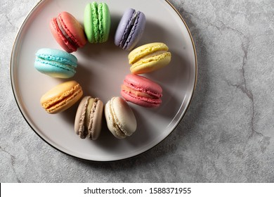 differnt color macaroons on a plate