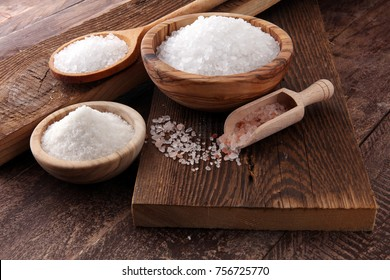 differnt kind of sugar in wooden bowl and spoon.