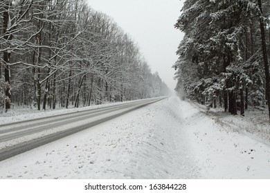 Difficult conditions in the winter. Snow on a Road