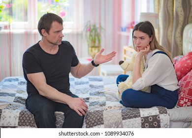 a difficult conversation with the daughter of a teenager with his father. They sit right in front of the camera and talk and look unhappy