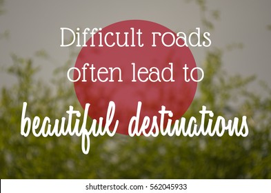 """Difficult roads often lead to beautiful destinations"" text on blurry nature background. Motivation concept."