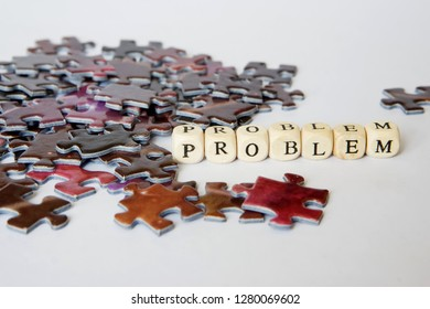 Difficult situation during the assembly of puzzles. Solving complex problems. Opportunities out of the problem situation. White background.