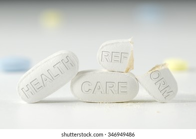 The difficulties of universal health care reform Obamacare laws and mandate represented on pills in a stack with a broken pill that says REFORM