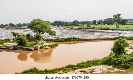 Dig site in a beautiful landscape. This image features water  way that leads to river Kaduna and a portion of the famous Kaduna quarry
