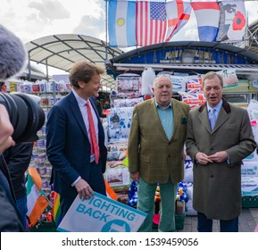 Digbeth, Birmingham / UK - April 13 2019: Nigel Farage and Richard Tice meet members of the public and the media during their tour of Indoor market Birmingham