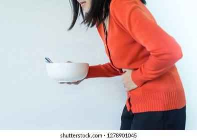 Digestion problems,Woman with stomach pain after eating,Hand female holding her belly