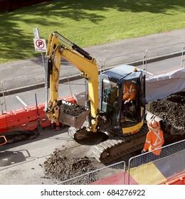 A digger excavating roadworks in Scott Street in preparation for light rail, Newcastle, Australia