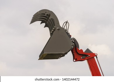 Digger excavator bucket bulldozer shovel grabber industrial detail on sky background