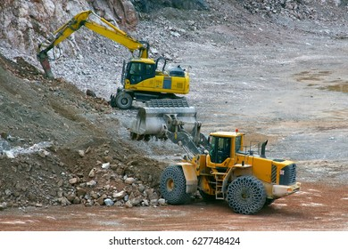 Digger and excavator in the quarry