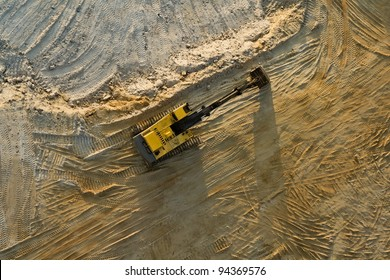 Digger in sand quarry from an aerial view