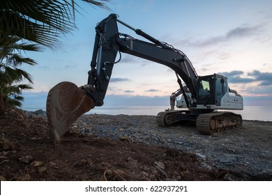 digger standing at the beach