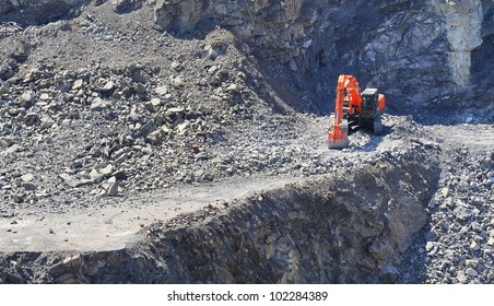 Digger in a stone mine