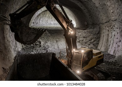digger in tunnel