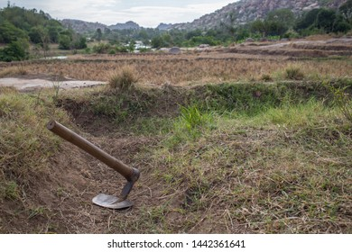 A digging shovel in a agricultural field on a summer afternoon in a south India