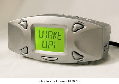 "Digital alarm clock with ""Wake Up!"" in the display.  Includes Photoshop paths."