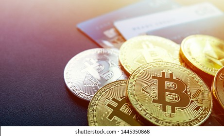 Digital assets are multi-coin bitcoin coins and credit cards. Is a financial technology based on blockchain, background sunset light