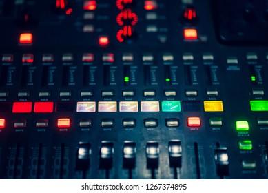 Digital audio mixer with a light button
