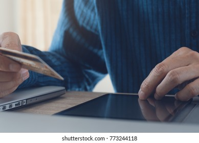 Digital banking, e commerce, Man using digital tablet for internet payment by credit card, online shopping, internet of things, omnichannel marketing concept