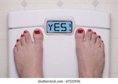 Digital Bathroom Scale Displaying YES Message
