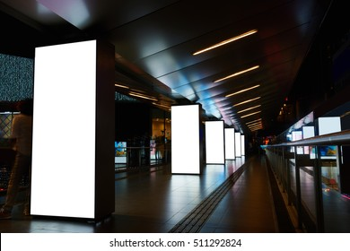 Digital billboards with clear copy space screen background for your text message or information content, electronic banner in night city, empty poster in metro setting, blank advertising mock up