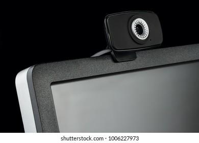 Digital black computer monitor screen and HD web camera on black background