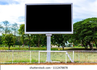 Digital blank scoreboard at football stadium with running track in sport stadium in outdoor ,Advertising Billboard LED, Empty black screen digital.