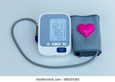 Digital blood pressure meter with love heart symbol isolated on white background
