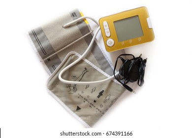 Digital Blood Pressure Monitor on white background.
