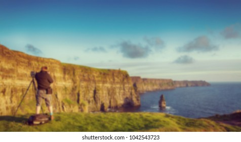 Digital blurred defocused style beautiful scenic irish countryside landscape from the cliffs of moher in county clare, ireland.
