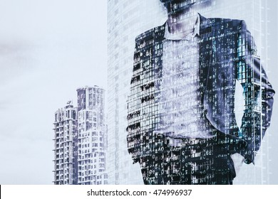 Digital business revolution concept. Double exposure of business man standing and abstract digital coding on building. Blue tone.