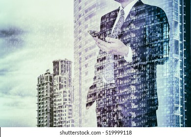 Digital business revolution concept. Double exposure of business man using smart phone and abstract digital coding on building. Blue tone.