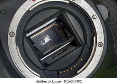 Digital Camera APS-C Sensor and lens mount close-up. Camera sensor CCD or Cmos closeup. Digital mirrorless camera APS-C CMOS sensor and lens bayonet.