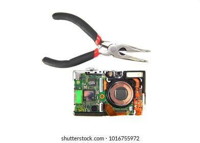 Digital camera disassembled on white background closeup