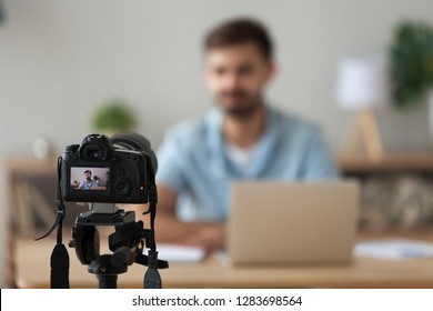 Digital camera filming commercial video blog or vlog of man teacher vlogger coach youtuber recording business course class or presentation training, device shooting videoblog youtube vlogging concept