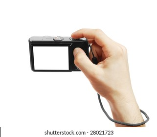 The digital camera in a hand