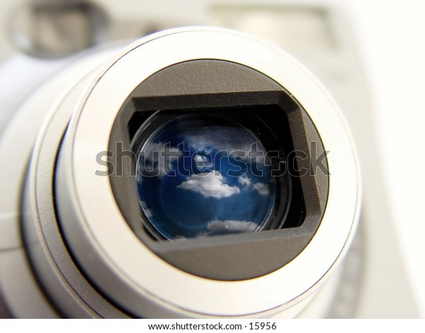 Digital Camera with picture of clouds reflected in the len