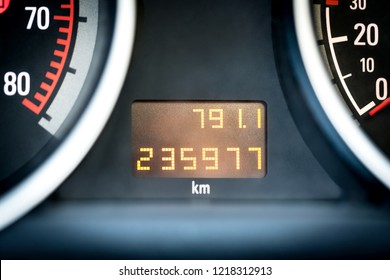 Digital car odometer in dashboard. Used vehicle with mileage meter. Numbers in kilometers.