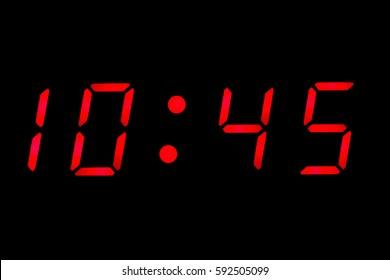 Digital clock closeup displaying 10:45