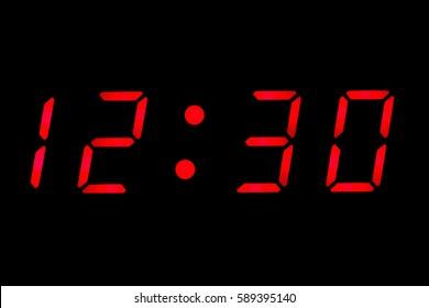 Digital clock closeup displaying 12:30
