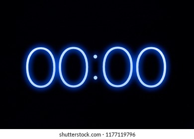 Digital clock timer stopwatch display showing 0 zero seconds remaining in glowing blue numbers. Emergency, urgency, out of time concept.