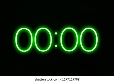 Digital clock timer stopwatch display showing 0 zero seconds remaining in glowing green numbers. Emergency, urgency, out of time concept.