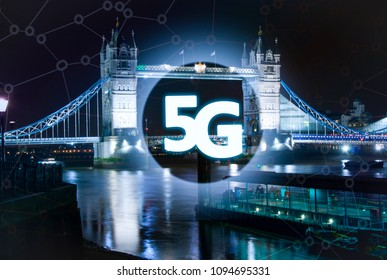 Digital composite of 5G with London tower bridge night lights on the background.5G world summit event, High speed mobile web technology concept in London.